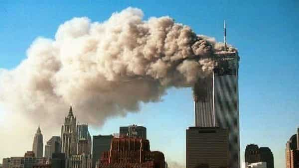 A file photo of the twin towers of World Trade Centre. Smoke pours from the twin towers after they were hit by two hijacked airliners in a terrorist attack 11 September 2001. (Photo: AFP)