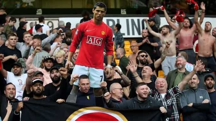 Manchester United fans with a cutout of Cristiano Ronaldo.