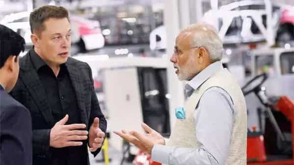 File Photo: Tesla CEO Elon Musk and Prime Minister Narendra Modi discussing Tesla's developments in battery technology.