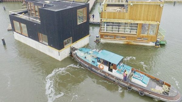 Amsterdam's floating village is home to over 100 residents who live in 46 homes on 30 water plots