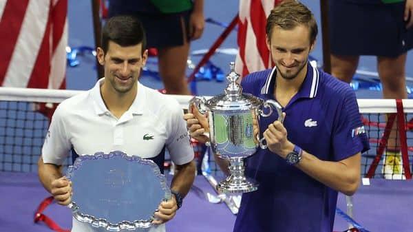 Novak Djokovic of Serbia holds the runner-up trophy alongside Daniil Medvedev of Russia (AFP)