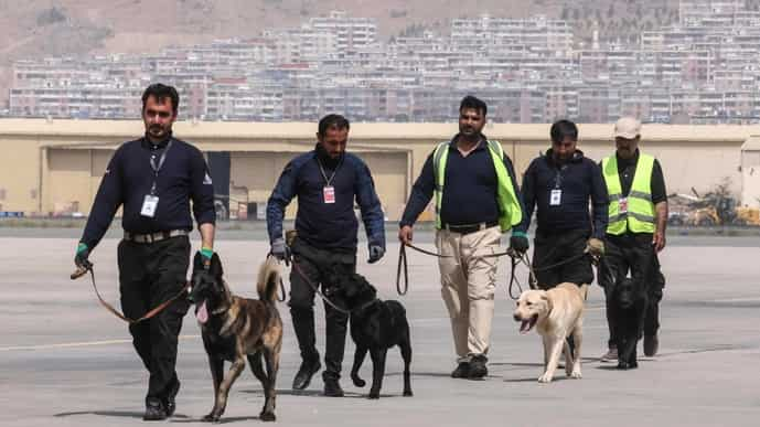 The dogs with their new handlers at Kabul airport.