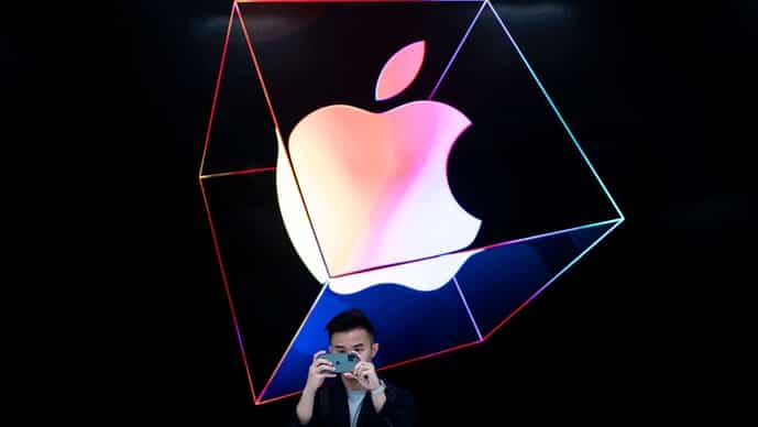 A man takes a picture with a new iPhone 11 inside the newly renovated Apple Store at Fifth Avenue in New York City.