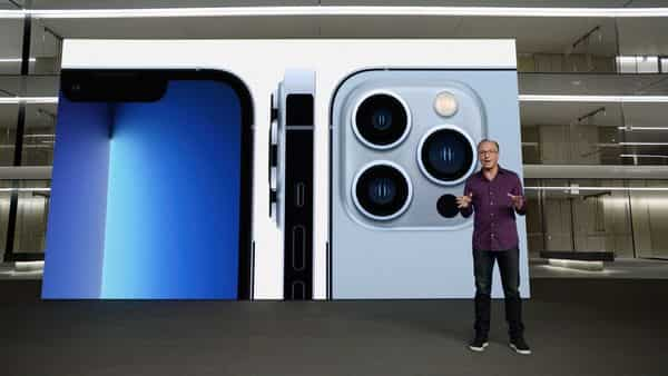 This handout image obtained September 14, 2021 courtesy of Apple Inc. shows Apple's senior vice president of Worldwide Marketing Greg Joswiak talking about the new iPhone 13 Pro. (AFP)