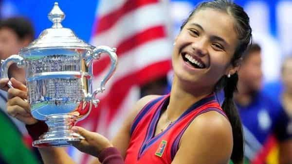 Emma Raducanu of Great Britain celebrates with the U.S. Open trophy after winning her maiden Grand Slam title at the USTA Billie Jean King National Tennis Center. Mandatory Credit: Robert Deutsch-USA TODAY Sports/File Photo