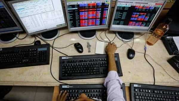 A broker monitors share prices while trading at a brokerage firm in Mumbai (REUTERS)