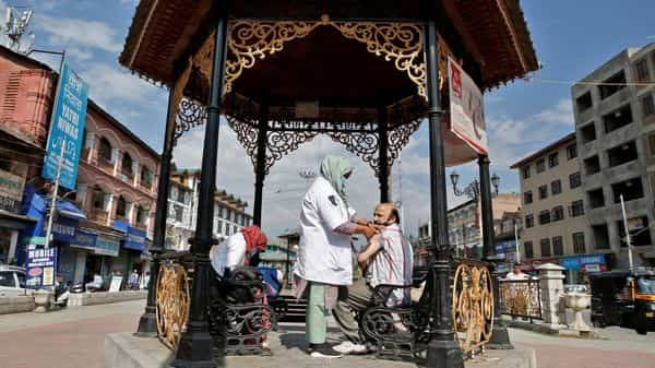 A man receives a dose of the Covid-19 vaccine in central Srinagar (REUTERS)