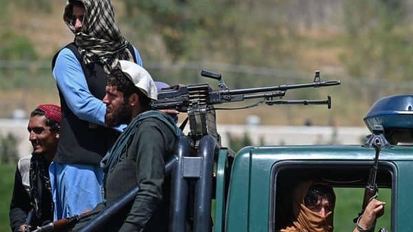 Taliban fighters patrol a street in Kabul (AFP)
