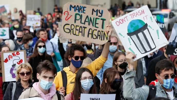 Environmental activists take part in a rally demanding actions to avert climate change in central Kyiv, Ukraine September 26, 2021.