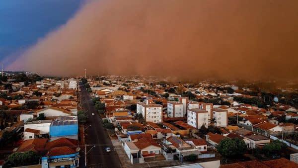 TOPSHOT - A massive dust storm is seen engulfing the neighbourhood of Nossa Senhora do Carmo at the city of Frutal, Minas Gerais state, Brazil (AFP)