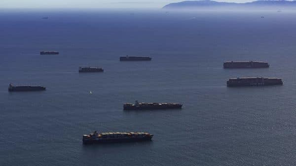 Container ships moored off the Los Angeles and Long Beach ports in Long Beach, California, U.S., on Saturday. (Bloomberg)