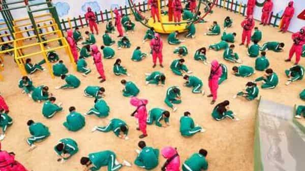 This undated photo released by Netflix shows a scene of contestants vying to win the Dalgona Korean candy challenge in a scene from Squid Game. Squid Game, a globally popular South Korea-produced Netflix show (AP)