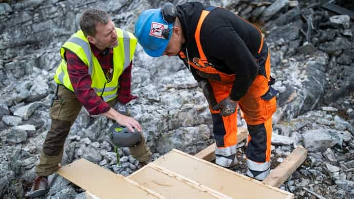 Geologist Anders Norby-Lie of the company Greenland Anorthosite Mining checks drilling cores at an exploration site of an anorthosite deposit close to the Qeqertarsuatsiaat fjord, Greenland, September 11, 2021.
