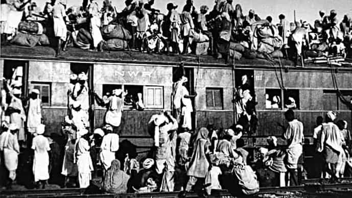 An overcrowded train transferring refugees during the partition of India.