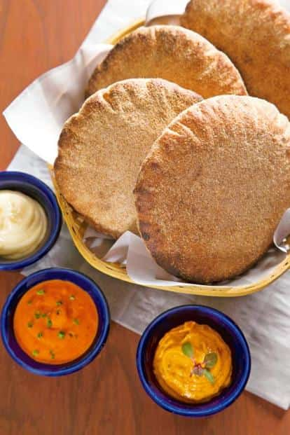 House-baked sourdough 'poi' with an assortment of flavoured butters.