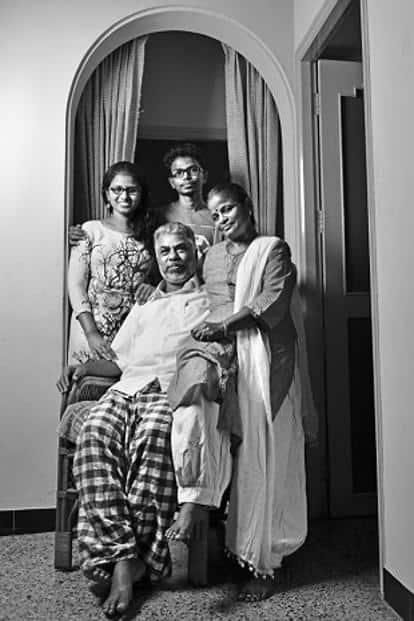 Murugan at his home in Namakkal, with wife Ezhilarasi, daughter Ilampirai and son Ilamparidhi.