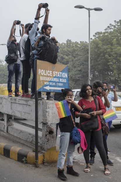 Photographers perched atop the divider at the junction of Barakhamba and Tolstoy Marg, from where the Pride march began on Sunday. Photo: Paroma Mukherjee