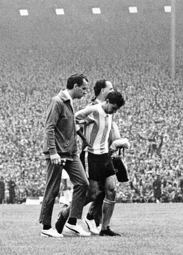 Argentinian captain Antonio Rattín (centre) walks off the field after being sent off during the 1966 World Cup quarter-final match against England. Photo: AFP