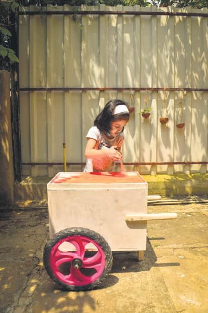 Govande's daughter Tara spray-paints an ice-cream truck. Photo: Aniruddha Chowdhury/Mint
