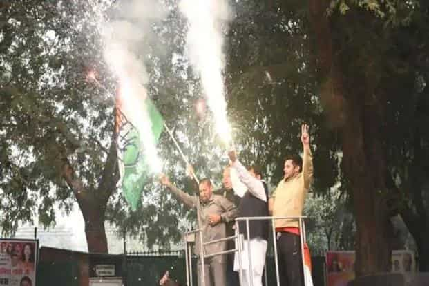 Congress workers celebrate at AICC headquarters in New Delhi. Photo: HT