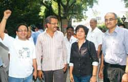 A file picture of the former Mid-Day publisher (right) and three journalists who were recently convicted for contempt of court