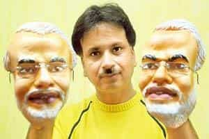 Unmasking success: Manish Bardia, CEO of The Moving Pixels, with the masks he designed for Gujarat chief minister Narendra Modi. (Amit Dave / Mint)