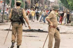 Strife zone: Policemen trying to control protestors in Kashmir on Tuesday. Violence continued in the Jammu region as well. Photograph: S. Irfan / PTI