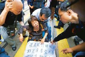 Hit hard: A file photo of Citibank clients who bought structured products from the bank protesting outside the bank's branch in China. Adam Dean / Bloomberg.