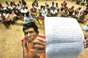 My land, my way: Villagers show a letter written to a government official that says they would not sell their land in Chitrakoot, Jagdalpur. Satish Bhate / Hindustan Times