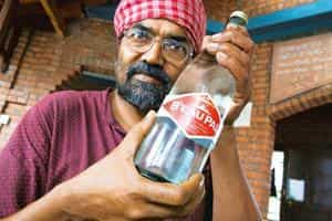 Toxic contents: Sarangi of Sambhavna Trust with a bottle of B'eau Pal. Madhu Kapparath / Mint