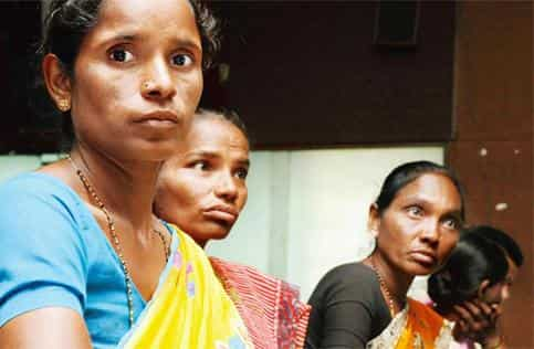 Seeking answers: Jamuna Kunta (left) with other widows. Kunta, whose husband committed suicide in Dubai, was in Hyderabad recently to tell her story to government officials, hoping for some help.Photo