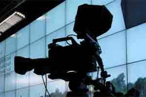 A television camera stands ready to film. Photo: Bloomberg