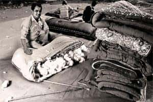 Dying craft: Shafiq says demand is dwindling because of competition from factory-made synthetic mattresses. Photo: Pradeep Gaur/Mint.