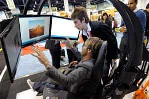 Visitors to the Consumer Electronics Show, in Las Vegas, try out a new computer workstation. Photo: AFP