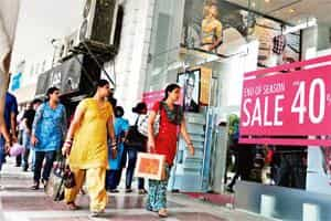 Attempting revival: A file photo of a retail store offering end-of-season sale in New Delhi. Besides sales, retailers are also looking to reduce inventory levels and are being more cautious about plac