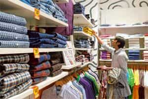 Vital stats: A customer checks out shirts at an Allen Solly store in Mumbai. Shirt sizes 39 and 40 have become the most popular for the retailer. Photo: Hemant Mishra/Mint