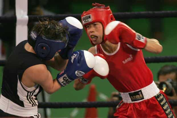 File photo of Indian boxer MC Mary Kom (R). The 51kg category world champion carries the hopes of the nation at the games. (AFP)