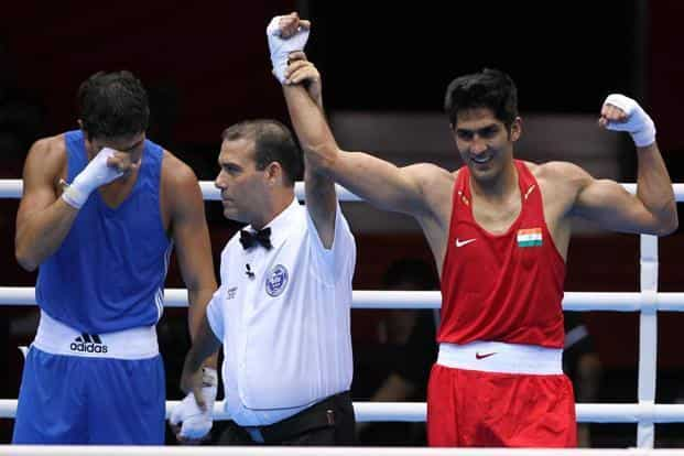 Indian Boxer Vijender Singh (R) celebrates after his victory over Kazakstan's Dan Suzhanov during their 75 kg bout. With this win Vijender booked a quarter-final berth in the men's middleweight category. (PTI)