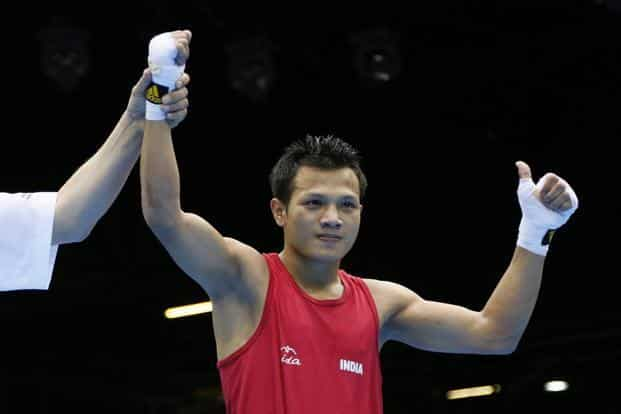 Devendro Singh Laishram of India is declared winner after stopping Bayron Molina Figueroa of Honduras in the first round of their first round Light Flyweight (49kg) boxing match. (AFP)