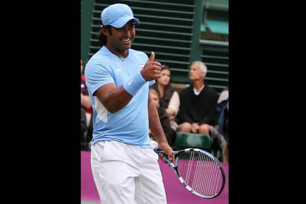 India's Leander Paes gestures during his doubles match against France M Llodra and JW Tsonga at the All England Lawn Tennis Club at Wimbledon, in London. While Paes lost in the men's doubles he and Sania Mirza defeated the Serbian pair of Nenad Zimonjic and Ana Ivanovic in straight sets to enter the mixed doubles quarter-finals on Thursday. (PTI)