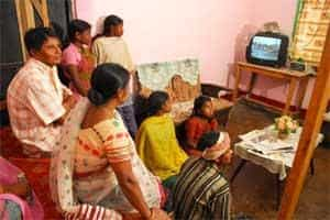 A file photo of a family watching television