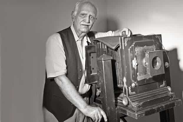 Veteran photographer Madan Mahatta, now 80, used Linhof Technika cameras for many years. He is posing here with a large-format studio camera that he once used for portraits.. Text and photographs by Ramesh Pathania/Mint.