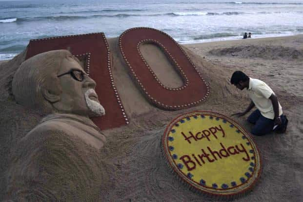 At a beach in Puri, artist Sudarshan Pattnaik applies the finishing touches to a sand sculpture of Amitabh Bachchan a day ahead of his 70th birthday. AP