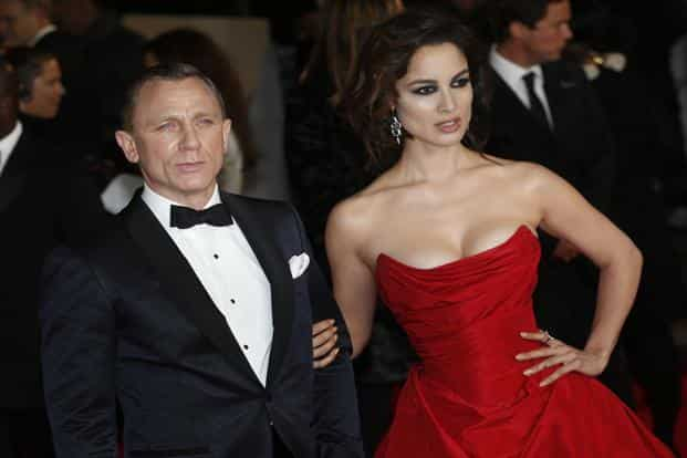 Actor Daniel Craig and new Bond girl, actress Berenice Marlohe pose for photographers as they arrive for the world premiere of the new 007 film