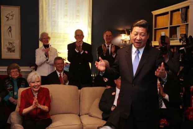 Xi jokes about receiving a gift of popcorn at the home of Roger and Sarah Lande in Muscatine, Iowa, during his first visit to Iowa in 1985. The new Chinese leader is known to maintain a low profile. AFP