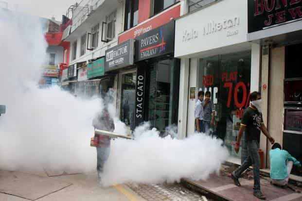 A file photo of workers fumigating Khan Market in New Delhi. Photo: HT