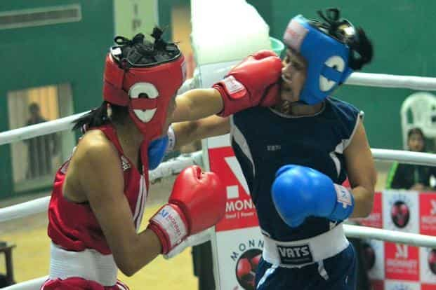 Sarjubala Devi (in red) lands a crushing blow at the 13th Senior National Women's Boxing Championships in Guwahati, Assam