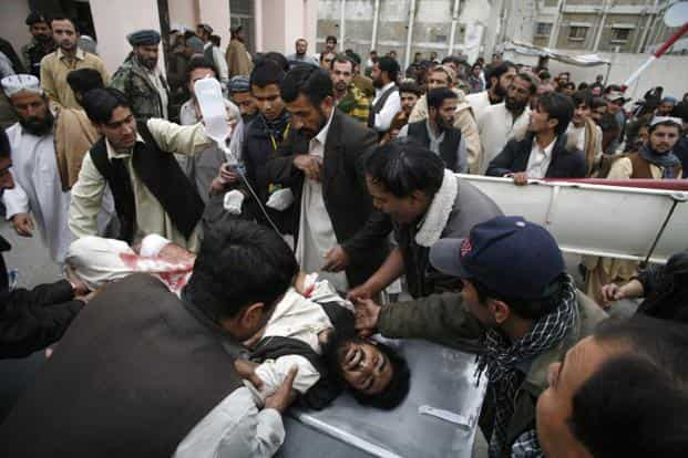 People take an injured man to a hospital in Quetta which has long been a flashpoint for attacks against Shiites, in particular those from the ethnic Hazara minority, according to an AFP news report. Reuters
