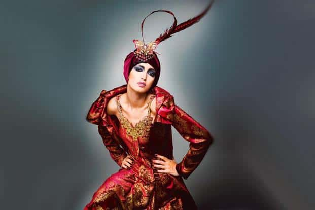 Silk velvet block-printed and bejewelled tunic and jacket with feathered turban. Collection: La Belle Époque, 2009; model: Tamara Moss. Photo: Vibhash Tiwari