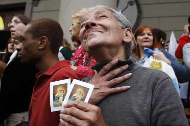 Roman Catholics celebrate the election of Pope Francis I in Buenos Aires, Argentina. Aged 76, he is just two years younger than Benedict at the time of his election in 2005. Reuters